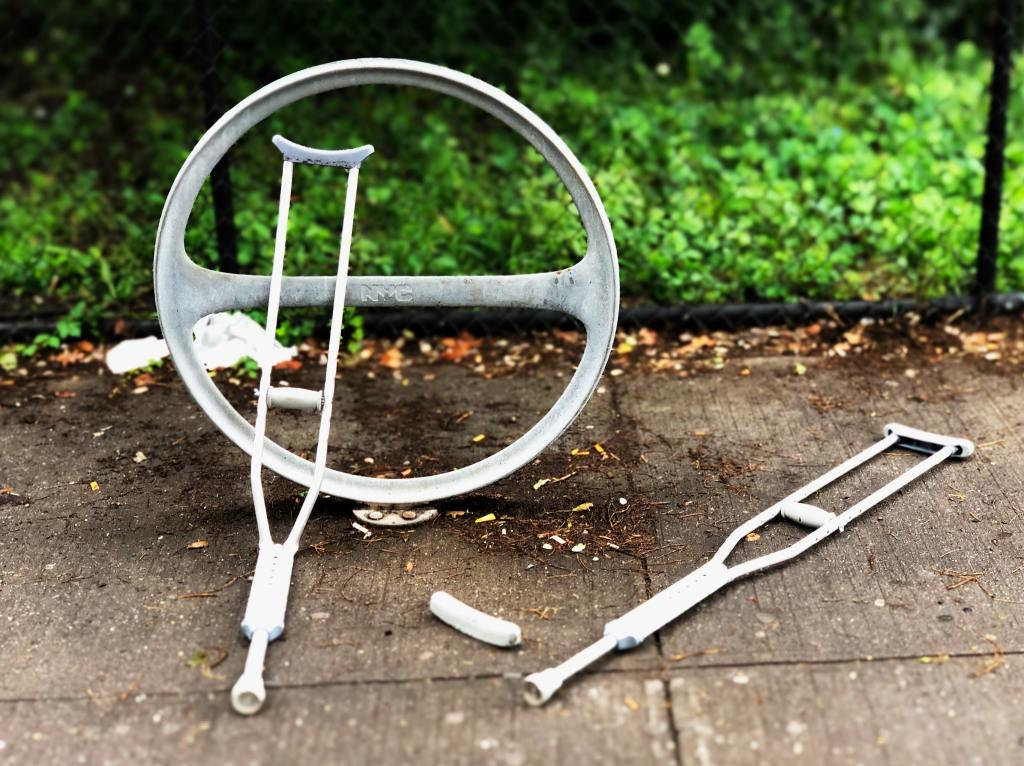 Crutches that have been abandoned by someone that doesn't need them, displaying how someone on sick leave might be found to be healthy with a fraud investigation.